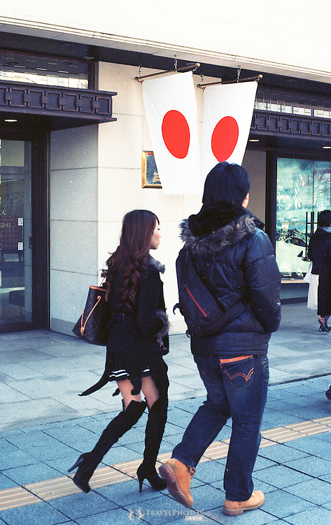 A young couple walking in Sakae on the official 2,672nd aniversary of Japan.