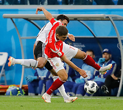 June 19, 2018 - Saint Petersburg, Russia - Roman Zobnin (R) of Russia national team and Trezeguet of Egypt national team vie for the ball during the 2018 FIFA World Cup Russia group A match between Russia and Egypt on June 19, 2018 at Saint Petersburg Stadium in Saint Petersburg, Russia. (Credit Image: © Mike Kireev/NurPhoto via ZUMA Press)