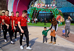 NANNING, CHINA - Thursday, March 22, 2018: Locals look on as Wales players go onc a team walk near the Wanda Realm Resort ahead of the 2018 Gree China Cup International Football Championship. (Pic by David Rawcliffe/Propaganda)