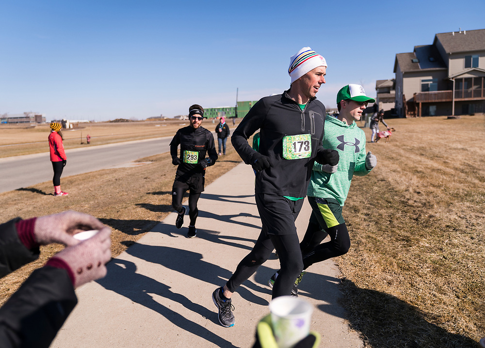 Democratic 2020 presidential candidate Beto O'Rourke, 46, runs a St. Patrick's Day 5K race during a three day road trip across Iowa, in North Liberty, Iowa, U.S., March 16, 2019.  REUTERS/Ben Brewer