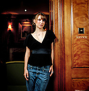 UK. London. Actress Nathalie Portman photographed in the 'library' in The Covent Garden Hotel..Photo©Steve Forrest