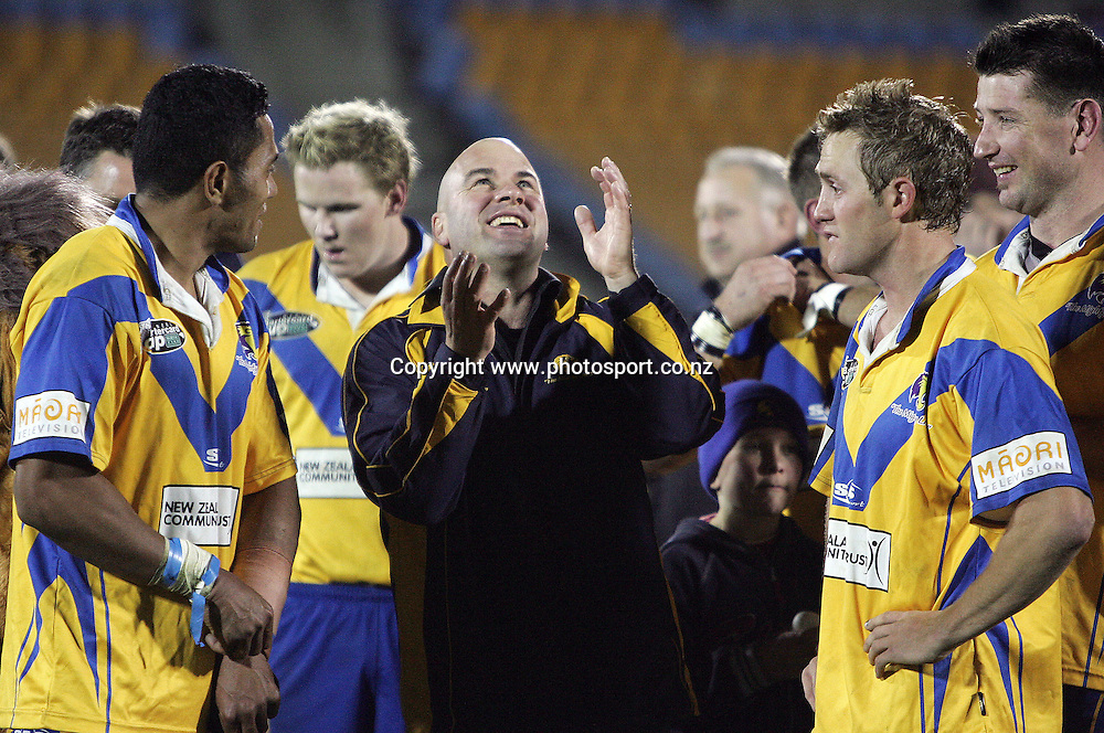Head coach Brian McClennan celebrates after winning the Bartercard Cup Final rugby league match between the Mt. Albert Lions and the Canterbury Bulls at Mt. Smart Stadium, Auckland, New Zealand on Monday 18 September, 2006. Photo: Hannah Johnston/PHOTOSPORT<br />