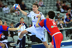 Peter Kukucka (4) of Slovakia vs Junggeu Park (8) of Korea during 21st Men's World Handball Championship 2009 Main round Group I match between National teams of Slovakia and Korea, on January 24, 2009, in Arena Zagreb, Zagreb, Croatia.  (Photo by Vid Ponikvar / Sportida)
