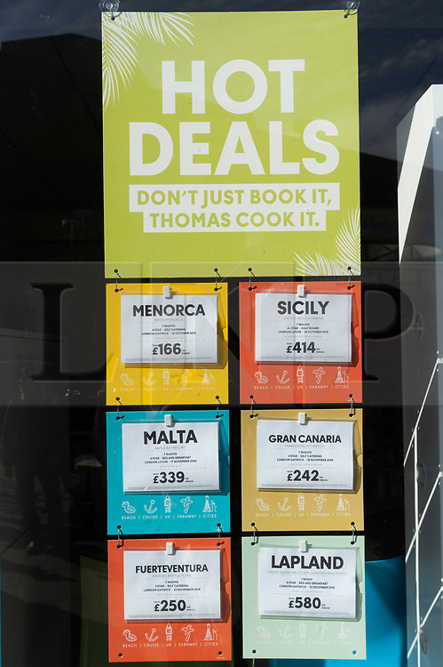 © Licensed to London News Pictures. 23/09/2019. London, UK.  A closed Thomas Cook holiday store window advertising holidays in North London. British holiday package firm Thomas Cook announced it is in administration.The company failed to raise an additional £200 million of funds to secure a rescue package was not forthcoming.Photo credit: Ray Tang/LNP