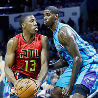 01 November 2015: Charlotte Hornets forward Marvin Williams (2) defends on Atlanta Hawks guard Lamar Patterson (13) during the Atlanta Hawks 94-92 victory over the Charlotte Hornets, at the Time Warner Cable Arena, in Charlotte, North Carolina, USA.