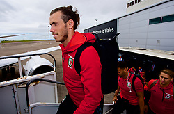 CARDIFF, WALES - Monday, September 4, 2017: Wales' Gareth Bale boards the team plane as the squad depart Cardiff Airport to travel to Chișinău ahead of the 2018 FIFA World Cup Qualifying Group D match against Moldova. (Pic by David Rawcliffe/Propaganda)