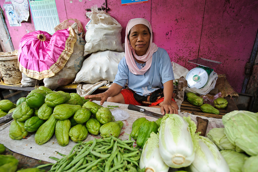 A women in a market selling fresh vegetables, Makassar, Sulawesi, Indonesia.