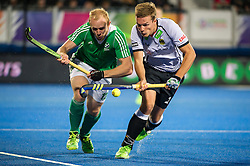 Ireland's Eugene Magee is tackled by Mathias Muller of Germany. Ireland v Germany - Unibet EuroHockey Championships, Lee Valley Hockey & Tennis Centre, London, UK on 23 August 2015. Photo: Simon Parker