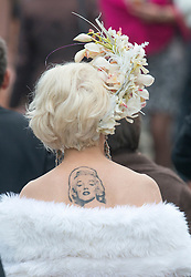 A Racegoer with a Marilyn Monroe tattoo on her back at Royal Ascot 2013, Ascot, United Kingdom,<br /> Thursday, 20th June 2013<br /> Picture by i-Images