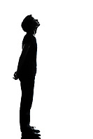 one caucasian young teenager silhouette boy or girl full length in studio cut out isolated on white background