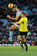 Aston Villa defender Nathan Baker (2) and Burton Albion striker Jamie Ward (12) during the EFL Sky Bet Championship match between Aston Villa and Burton Albion at Villa Park, Birmingham, England on 26 December 2016. Photo by Richard Holmes.