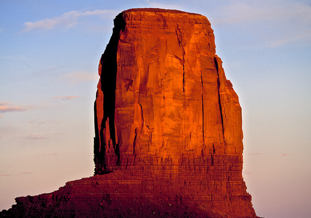 Sunset light turns Castle Butte almost red in Monument Valley, Utah.