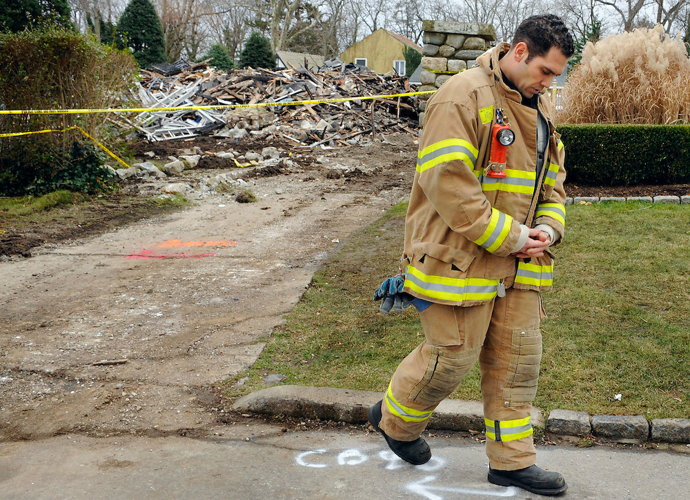 Stamford firefighter Nick Tamburro pays respect outside the home of Madonna Badger in Stamford, Conn.  A fire at the home on Christmas morning killed Badger's three daughters and parents. The Christmas Day fire that killed three children and their grandparents was a tragic accident related to a fireplace in the home, not the result of foul play, Stamford Mayor Michael Pavia said Tuesday, Dec. 27, 2011. (AP Photo/Jessica Hill)