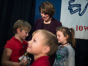 05 DECEMBER 2019 - DES MOINES, IOWA: US Senator AMY KLOBUCHAR (D-MN) talks to a group of children who watched her at a campaign event in Des Moines. The children and their mother (not in photo) were on stage for a selfie with Sen. Klobuchar. Sen. Klobuchar is campaigning to be the Democratic nominee for the US Presidency. Iowa holds the first selection event of the Presidential election cycle. The Iowa caucuses are Feb. 3, 2020.                   PHOTO BY JACK KURTZ