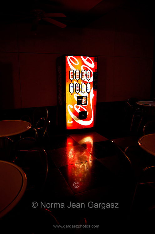 A machine for purchasing Coca Cola soda sits on a covered patio on a college campus, Tucson, Arizona, USA.
