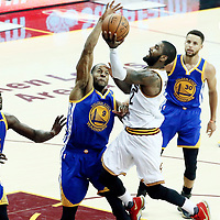 09 June 2017: Cleveland Cavaliers guard Kyrie Irving (2) goes for the layup against Golden State Warriors forward Andre Iguodala (9) and Golden State Warriors forward Draymond Green (23) during the Cleveland Cavaliers 137-11 victory over the Golden State Warriors, in game 4 of the 2017 NBA Finals, at  the Quicken Loans Arena, Cleveland, Ohio, USA.