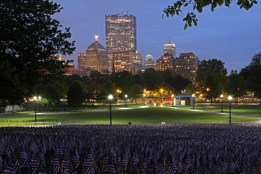 Boston photography from New England based fine art photographer Juergen Roth showing the Garden of American Flags in the Boston Common on Memorial Day. The Military Heroes Garden of American flags in Boston Common displays nearly 37,000 American flags, each flag represents the lost life of a fallen service member from Massachusetts since the Revolutionary War (1775 - 1783) to the present in 2014. Visitors are reminded of the essence of the Memorial Day holiday through this deeply moving site.<br />