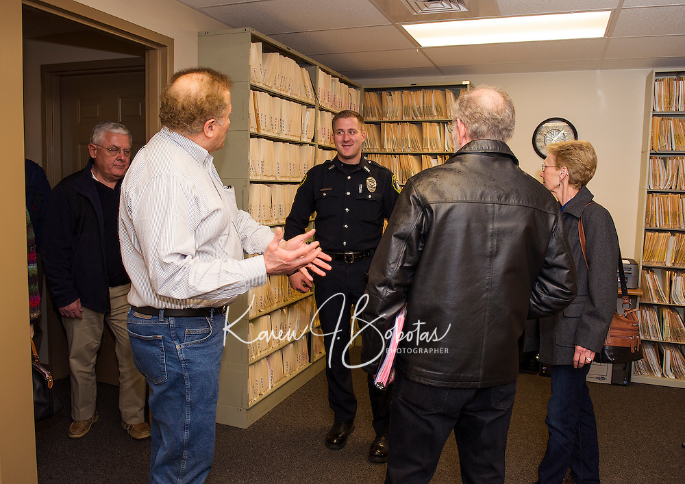 John O'Brien, Norman Silber, Jack and Charlotte Landow get a tour of the Gilford Police Department with Officer Callahan during their Open House Thursday evening.  (Karen Bobotas/for the Laconia Daily Sun)