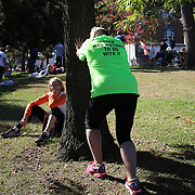 A runner stretches after the ING Hartford Marathon, Bushnell Park, Hartford. Connecticut. USA. Hartford, Connecticut, USA. 12th October 2013. Photo Tim Clayton