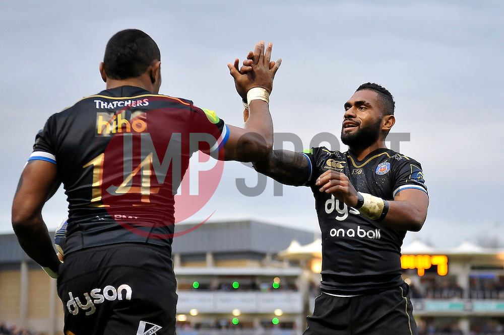 Semesa Rokoduguni of Bath Rugby is congratulated on his try by team-mate Niko Matawalu - Mandatory byline: Patrick Khachfe/JMP - 07966 386802 - 19/12/2015 - RUGBY UNION - The Recreation Ground - Bath, England - Bath Rugby v Wasps - European Rugby Champions Cup.