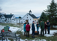 Prescott Farm Environmental Center staff welcomes folks to gather around the fire pit to share stories as the sun sets on Saturday afternoon during their Winter Solstice celebration.  (Karen Bobotas/for the Laconia Daily Sun)