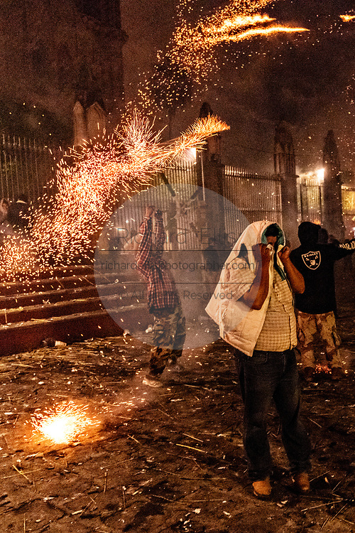 Residents scramble as they are pelted by pyrotechnic rockets during the Alborada festival September 29, 2018 in San Miguel de Allende, Mexico. The unusual festival celebrates the cities patron saint with a two hour-long firework battle at 4am representing the struggle between Saint Michael and Lucifer.