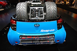 08 February 2012:  Scion Pit Boss Carel iQ by Cartel.  Outfitted for off the road it carries extra wheels, a pair of jacks and even tool trays on the rear with a roll cage around the seating area. Chicago Auto Show, Chicago Automobile Trade Association (CATA), McCormick Place, Chicago Illinois