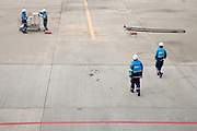 maintenance crew waiting for airplane to arrive at Narita International airport Tokyo Japan