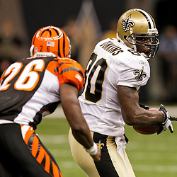 2009 August 14: New Orleans Saints tight end Darnell Dinkins (80) runs after a catch as Cincinnati Bengals safety Marvin White (26) pursues during 17-7 win by the New Orleans Saints over the Cincinnati Bengals in their preseason opener at the Louisiana Superdome in New Orleans, Louisiana.