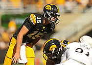 September 21 2013: Iowa Hawkeyes quarterback Jake Rudock (15) yells down the line during the first quarter of the NCAA football game between the Western Michigan Broncos and the Iowa Hawkeyes at Kinnick Stadium in Iowa City, Iowa on September 21, 2013. Iowa defeated Western Michigan 59-3.