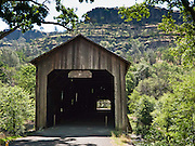 Honey Run Covered Bridge was built in 1894 on Butte Creek, halfway between Chico and Paradise in Butte County, California, USA. Pedestrians and bicycles can cross, but a damaging car crash in 1965 closed the bridge to auto traffic, which was rerouted to a steel bridge upstream.