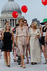 © Licensed to London News Pictures. 19/08/2012. London,UK.  Millie Mackintosh, of reality TV show Made in Chelsea, participating in exclusive fundraising walk The Sunday Strut, in aid of The Princes Trust.  Here she crosses the Millennium Bridge with St Paul's Cathedral behind her.  Photo credit : Richard Isaac/LNP