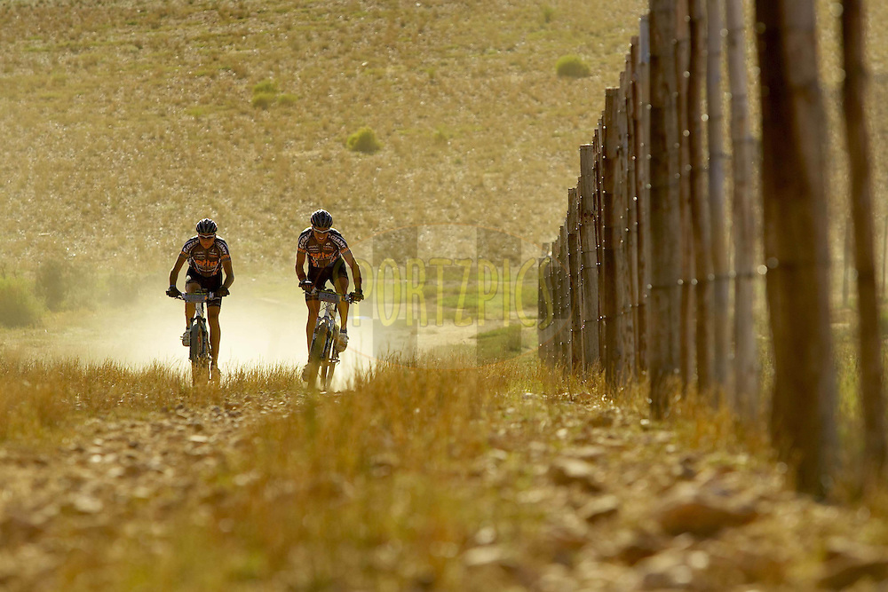 WESTERN CAPE, SOUTH AFRICA -  30 March 2008, Jo Nordskar.and Anders Hovdenes of Team Etto Hoydahl 1 race near Wolwedans during stage two of the 2008 Absa Cape Epic Mountain Bike stage race from Saasveld Campus Nelson Mandela Metropolitan University in George to Calitzdorp Spa, Calitzdorp in the Western Cape, South Africa..Photo by Gary Perkin/SPORTZPICS