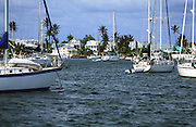 sailboats anchored in harbour; houses on shore; Hopetown; Elbow Cay; Islands of the Bahamas; spring