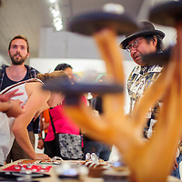 080914       Cable Hoover<br /> <br /> Silversmith Norbert Peshlakai shows his work to visitors at Art123 Gallery during ArtsCrawl Saturday in downtown Gallup.