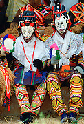 Tribal dancers in dramatic costumers at festival in Cameroon, West Africa - RESERVED USE