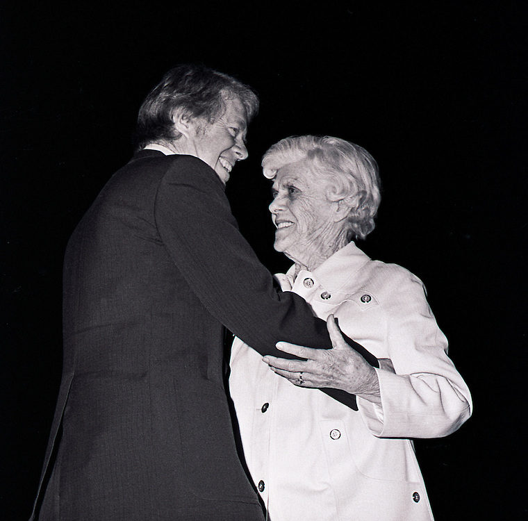 President Jimmy Carter hugs his mother Lillian Carter as she arrives at the White House. - To license this image, click on the shopping cart below -