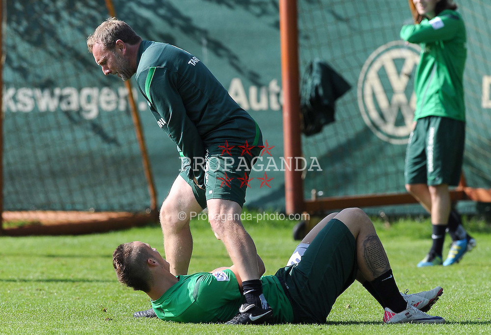 23.08.2011, Trainingsgelaende, Bremen, GER, 1.FBL, Training Werder Bremen, im Bild Marko Arnautovic (Bremen #7, unten), Matthias Hönerbach / Hoenerbach (Co-Trainer Werder Bremen, oben)..// during training session of Werder Bremen on 2011/08/23, Trainingsgelaende, Bremen, Germany..EXPA Pictures © 2011, PhotoCredit: EXPA/ nph/  Frisch       ****** out of GER / CRO  / BEL ******