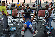 2016/06/07 – Bogotá, Colombia: Fábio Torres, 39, lifts 240kgs under the supervision of his coach Henri Oviedo during a training session in the High Performance Center, Bogotá, 7th June, 2016.<br /> -<br /> Fábio is a retired Army Corporal. In 2008, he stepped on a landmine while on patrol in the Colombian jungle, losing his left leg. The accident became a big change in Fabio's life; he felt he had to learn everything again. Fábio found strength to continue his life through sport, and specially powerlifting, which he at first just practiced as hobby. Since 2009 he dedicates all his time to the sport, in the beginning just as a rehabilitation process and now as fulltime sportsman. He has had a successful year, in 2016; Fábio became World Champion of Powerlifting in Brazil after lifting 211kg. In the Rio 2016 Paralympics, he wants to bring a medal home. Regarding the violence in his country, he hopes that the peace process goes further. There are already too many victims, and he doesn't want people to go through what he has been through. He believes that the country need less violence and more sports, so they can get peace in Colombia. (Eduardo Leal)