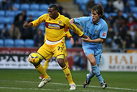 Photo: Pete Lorence.<br />Coventry City v Burnley. Coca Cola Championship. 09/12/2006.<br />Gifton Noel-Williams and Elliott Ward battle for the ball.