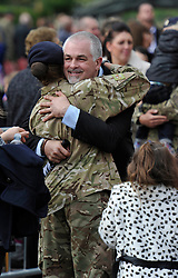 © Licensed to London News Pictures. 4 October 2013. Didcot Oxfordshire. Proud dad hugs daughter. Princess Anne awarded campaign medals to 11 EOD Bomb Disposal regiment today in Didcot Oxfordshire. Photo credit : MarkHemsworth/LNP