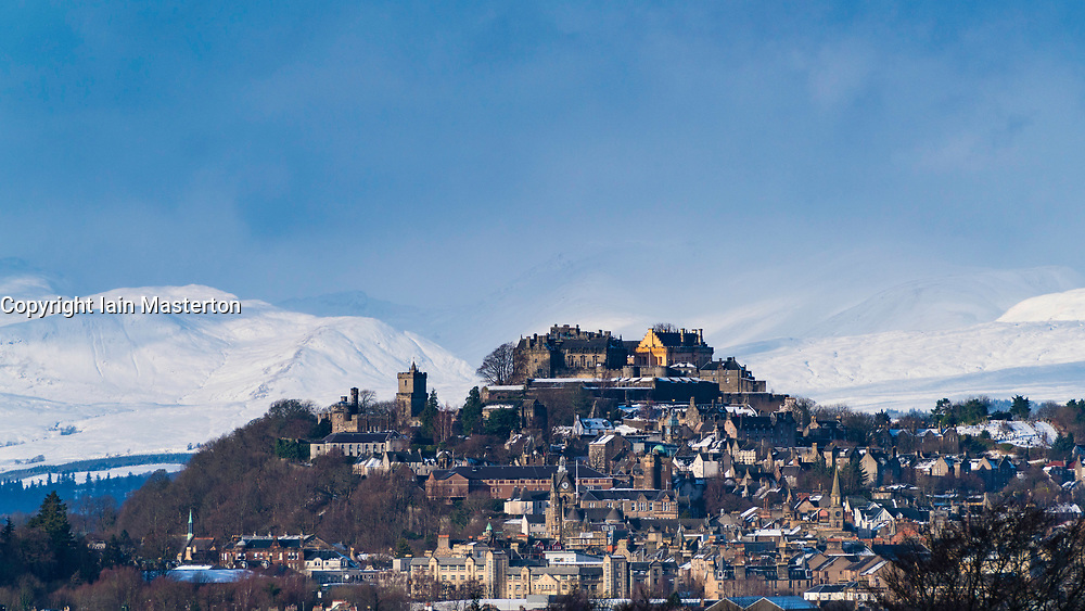 View of Stirling Castle with snow covered mountains in distance, Scotland, United Kingdom.