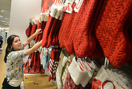 """RETAIL11P<br /> Megan Shoemaker, of Fairless Hills, Pennsylvania works on a Christmas stocking display at Kohl's Friday October 2, 2015 in Yardley, Pennsylvania.  Kohl's plans to add 69,000 seasonal jobs, with hiring to start this month, """"to ensure an easy shopping experience and great service during the busy holiday shopping season.""""  William Thomas Cain /For The Inquirer"""