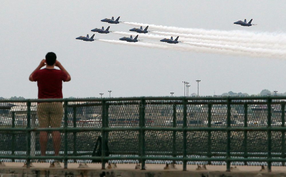 (Boston, MA - 5/26/15) A man looks on as the Blue Angels fly in formation near Castle Island, Tuesday, May 26, 2015. Staff photo by Angela Rowlings.