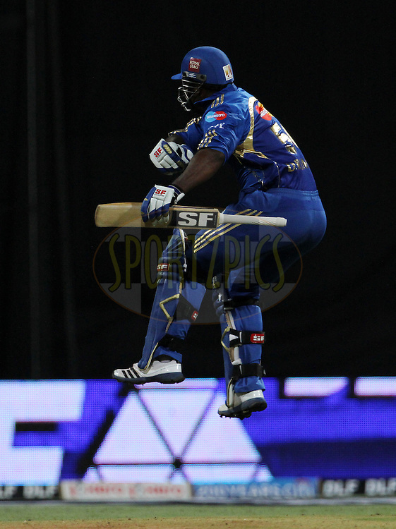 Mumbai Indian player Dwayne Smith celebrates after hitting the winning runs during match 49 of the Indian Premier League ( IPL) 2012  between The Mumbai Indians and the Chennai Superkings held at the Wankhede Stadium in Mumbai on the 6th May 2012..Photo by Vipin Pawar/IPL/SPORTZPICS.