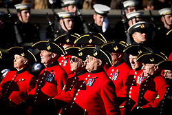 © London News Pictures. 11/11/2012. London, UK. Chelsea Pensioners dressed in traditional red uniforms march down Whitehall during a Remembrance Day Ceremony at the Cenotaph on November 11, 2012 in London, United Kingdom. Photo credit: Ben Cawthra/LNP