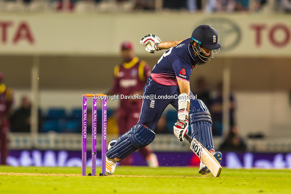 London,UK. 27 September 2017.  Moeen Ali makes his ground taking a quick single. England v West Indies. In the fourth Royal London One Day International at the Kia Oval.