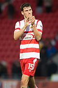 Doncaster Rovers Defender Joe Wright (15) gestures towards the Doncaster fans during the The FA Cup match between Doncaster Rovers and Scunthorpe United at the Keepmoat Stadium, Doncaster, England on 3 December 2017. Photo by Craig Zadoroznyj.