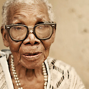 African elderly woman wearing glasses