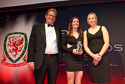 CARDIFF, WALES - Monday, October 5, 2015: Wales' Helen Ward receives the Women's Player of the Year Award from Brains John Rees and National Team manager Jayne Ludlow during the FAW Awards Dinner at Cardiff City Hall. (Pic by David Rawcliffe/Propaganda)